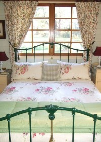 Queen bed with french doors and deck overlooking views of valley and Blue mountains